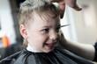 Laughing kid at barbershop