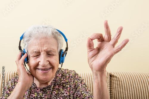 senior woman listening music Canvas Print