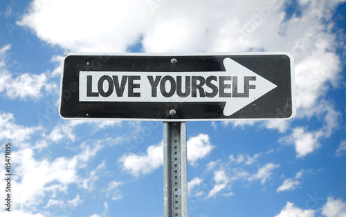 Love Yourself direction sign with sky background Canvas Print