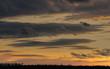 Man on horizon watching Sunset