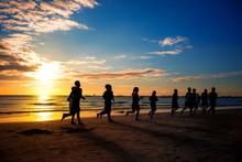 People Runs At The Beach On Beautiful Summer