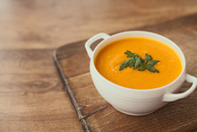 Carrot Cream Soup On The Wood Table