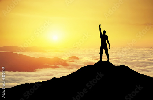 Poster de jardin Alpinisme Winner silhouette on the mountain top. Sport and active life concept.