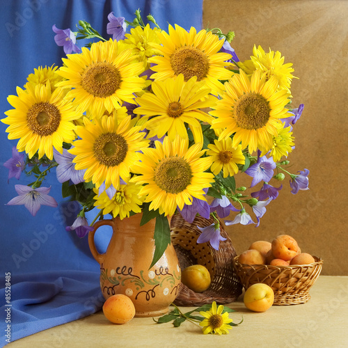 Still life with sunflowers and fruits on artistic background - 85528485