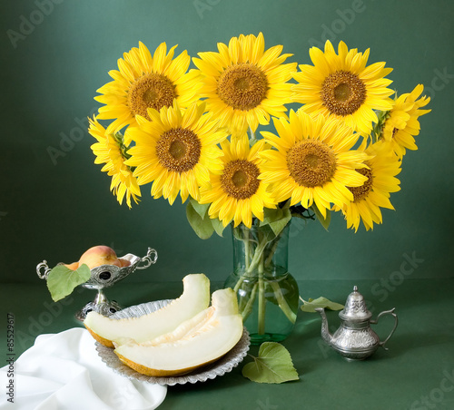 Still life with sunflowers and fruits on artistic background - 85529617