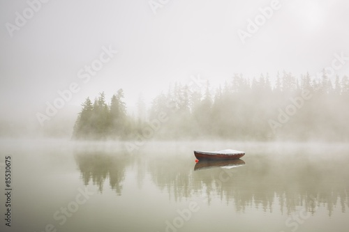 Boat in mysterious fog Canvas Print