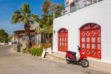 Red Motorbike In Front Of Typical Greek House