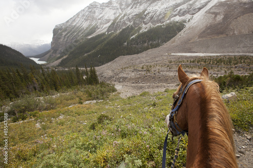horseback riding through Lake Louise Banff during snow storm