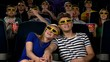 Couple in cinema watching a movie with 3D glasses