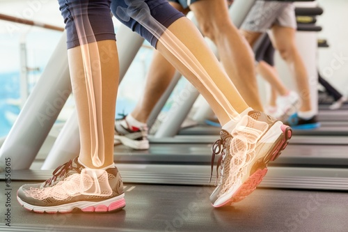 Highlighted ankle of woman on treadmill Tablou Canvas