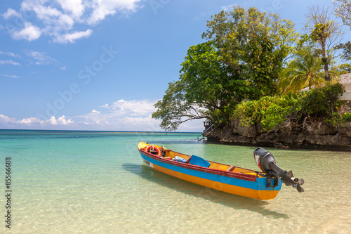 Foto  Fish boat on the paradise beach