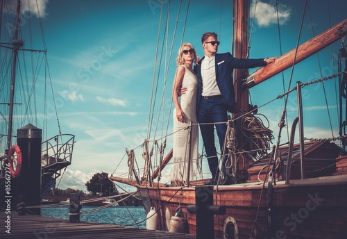Fototapeta Stylish wealthy couple on a luxury yacht obraz