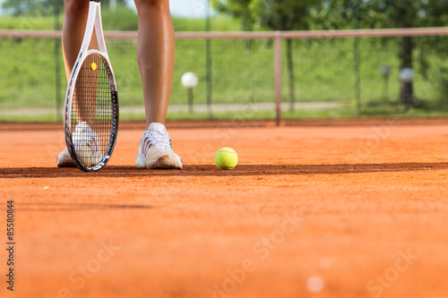 Legs of female tennis player.Close up image. Wallpaper Mural