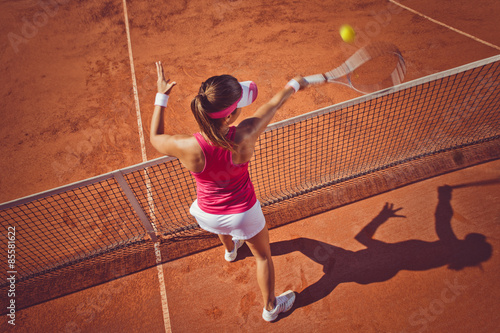 Young woman playing tennis.High angle view.Forehand volley. Tableau sur Toile