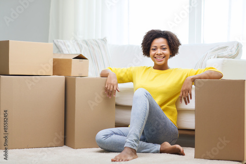 Fényképezés  happy african woman with cardboard boxes at home