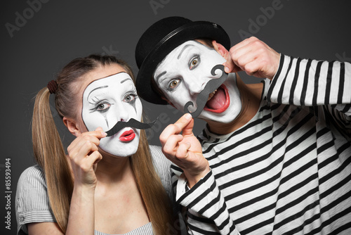 Plakát  Couple of mimes with paper mustaches