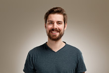 Portrait Of Smiling Young Man With Beard