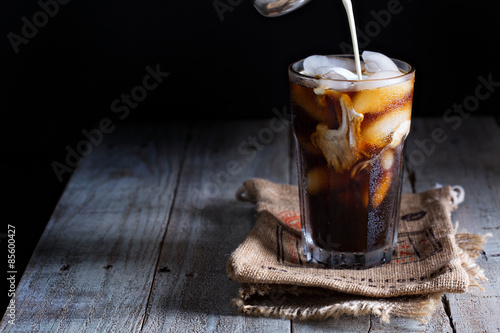 Photo Iced coffee in a tall glass