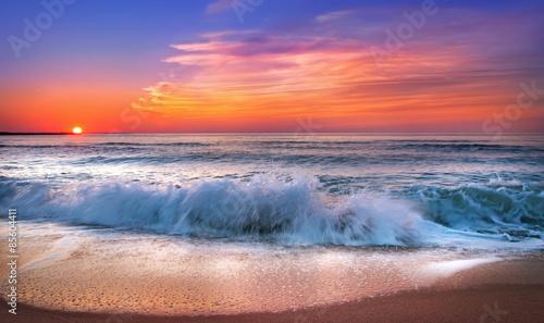 Fotografia Sunset on the beach of caribbean sea.