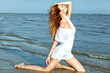 Beach vocation. Beautiful youmg woman in white dress on the beac