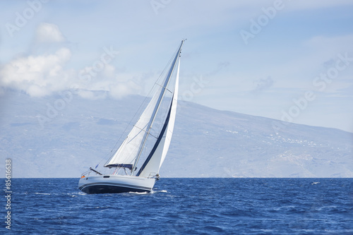 Wind in yacht sails with beautiful sky. Luxury yachts.