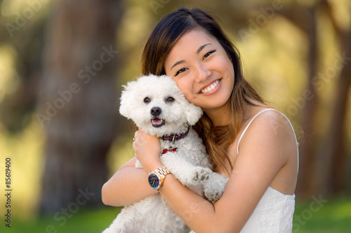 Photo  Little dog with owner spend a day at the park playing and having fun