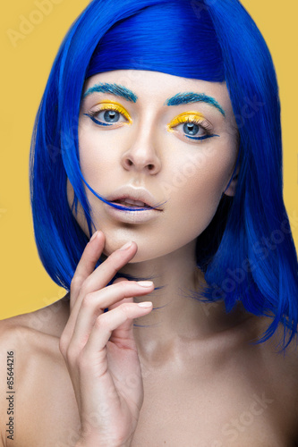 Fotografie, Obraz  Beautiful girl in a bright blue wig in the style of cosplay and creative makeup