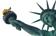 The Head And The Torch Of The Statue Of Liberty On White Background