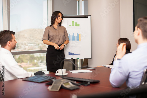 Woman giving a sales pitch Canvas Print