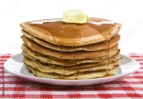 Fotografie, Obraz  Big Stack of Pancakes – A huge stack of pancakes, covered with maple syrup and butter