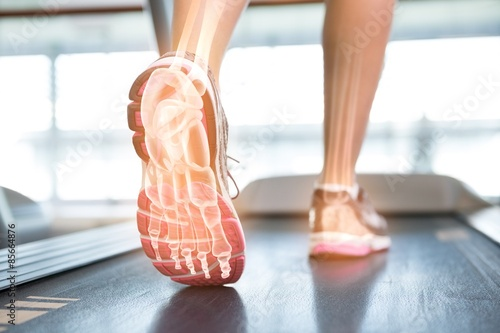 Highlighted foot of woman on treadmill Canvas Print