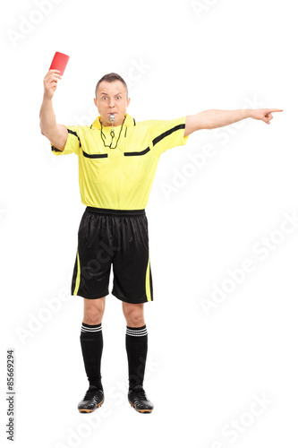 Angry football referee showing a red card Canvas Print