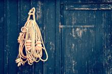 Fish Rope Hanging On A Wooden Black Door