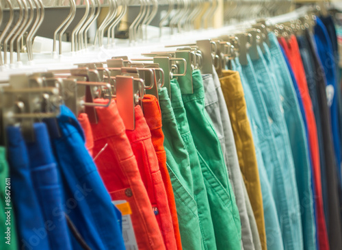 Fotografie, Obraz  Colorful hipster trousers hanging on sale in store