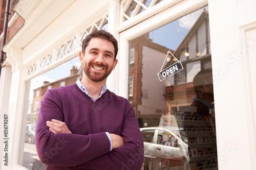 Fotografie, Obraz  Shop owner standing next to his shop