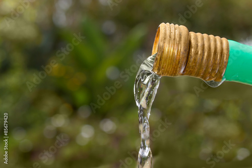 Fotografie, Obraz  Water flowing down from garden hose close up