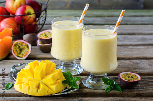 Tropical mango and passion fruit smoothie for healthy breakfast #85681872