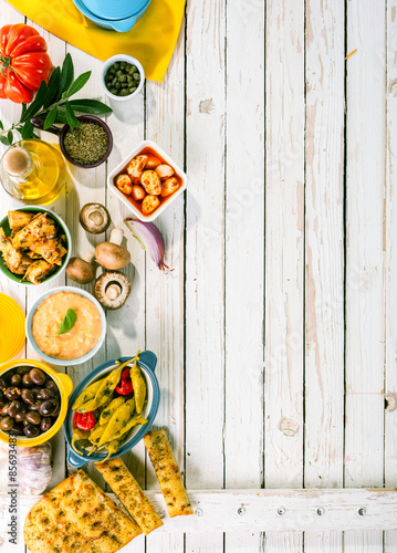 Fotografie, Obraz  Mediterranean Appetizers on White Picnic Table