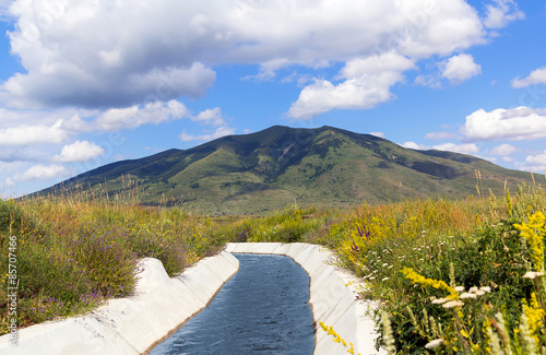 Poster Channel View of Mount Arailer. Irrigation canal in the valley between the mountains. Armenia