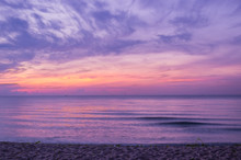 Sunrise Sky Over Sea And Beach In Purple Filter.
