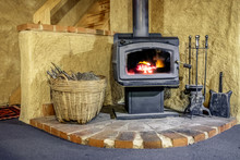 Wood Fired Stove In Mudbrick Cottage