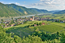 Wachau, Austria - June 17, 2015: Scenic View Into The Wachau With The River Danube And The Market Town Weissenkirchen In Lower Austria. Famous UNESCO Cultural Landscape Known For Its Wine.