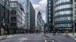 Timelapse view of a busy crossroad at a traffic light in the hearth of the financial district of the City of London, near Liverpool street train station