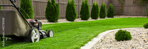 Photo Stands Garden Lawn mower on green lawn