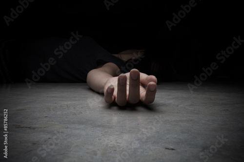 The dead woman's body. Focus on hand Wallpaper Mural