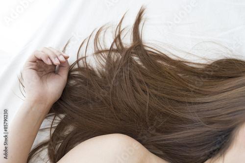 Hair of the woman sleeping in bed Wallpaper Mural