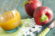 Group of fresh peaches and juice on vintage wooden