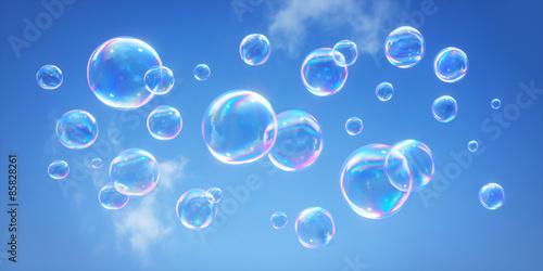 Fotografering  Seifenblasen vor blauem Himmel