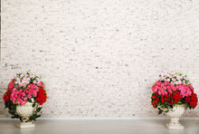 Empty Room With White Brick Wall And Beautiful Flowers In Pots