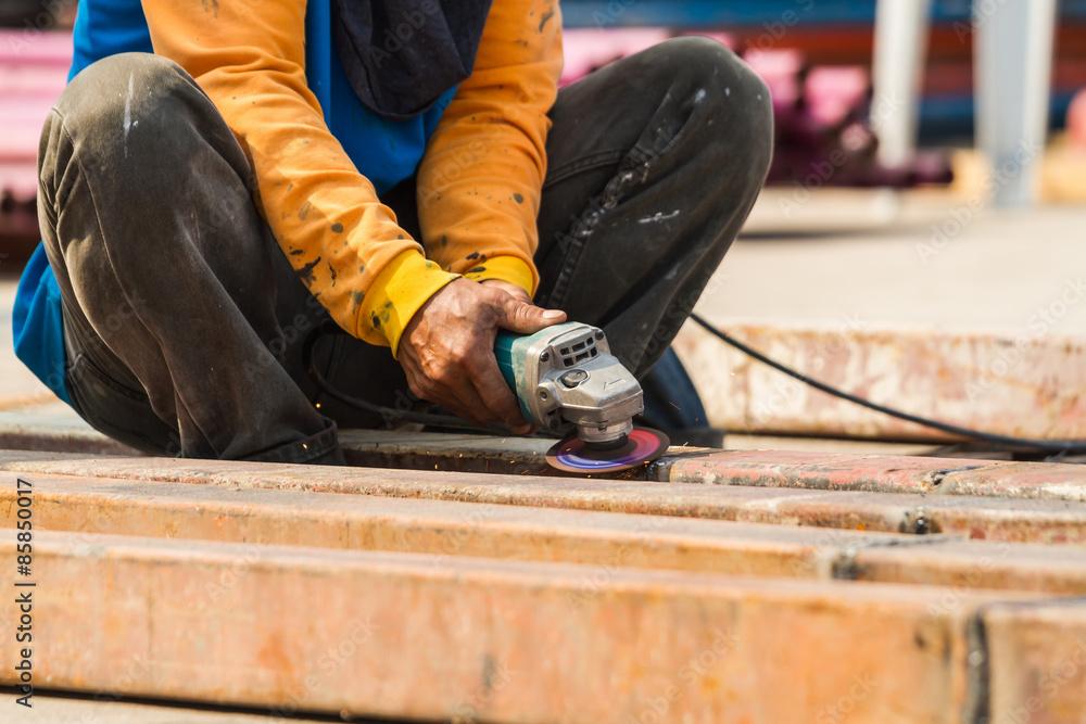 Fototapeta Steel Workers welding, grinding, cutting in metal industry - obraz na płótnie